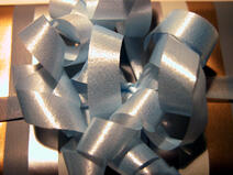 Shiny blue gift-wrapping bow