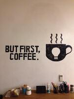 "Poster that reads ""But First, Coffee."""