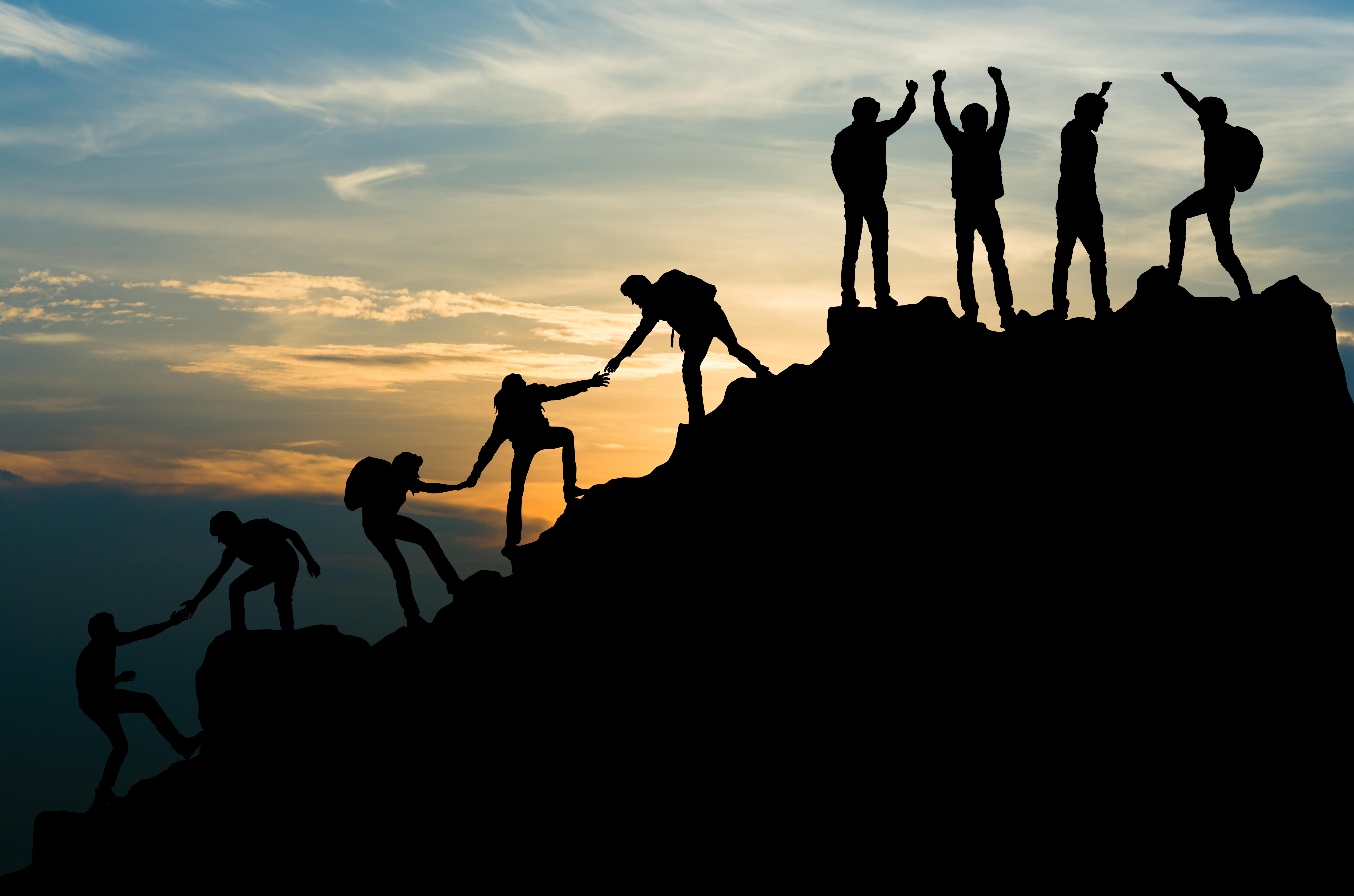 Group climbing up mountain